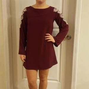 Burgundy long sleeve dress with open back